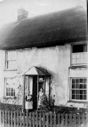 Pitts couple at door of Morchard cottage