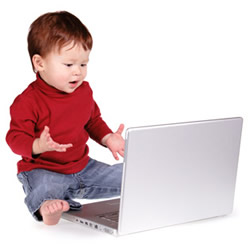 toddler with laptop